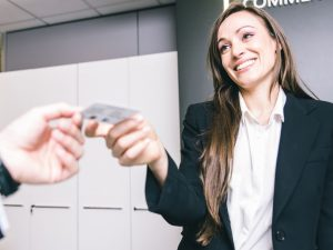 a woman handing someone her business card