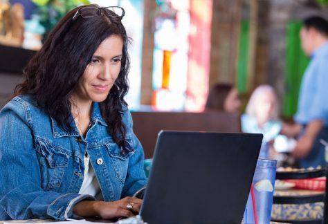 woman looking at laptop monitor